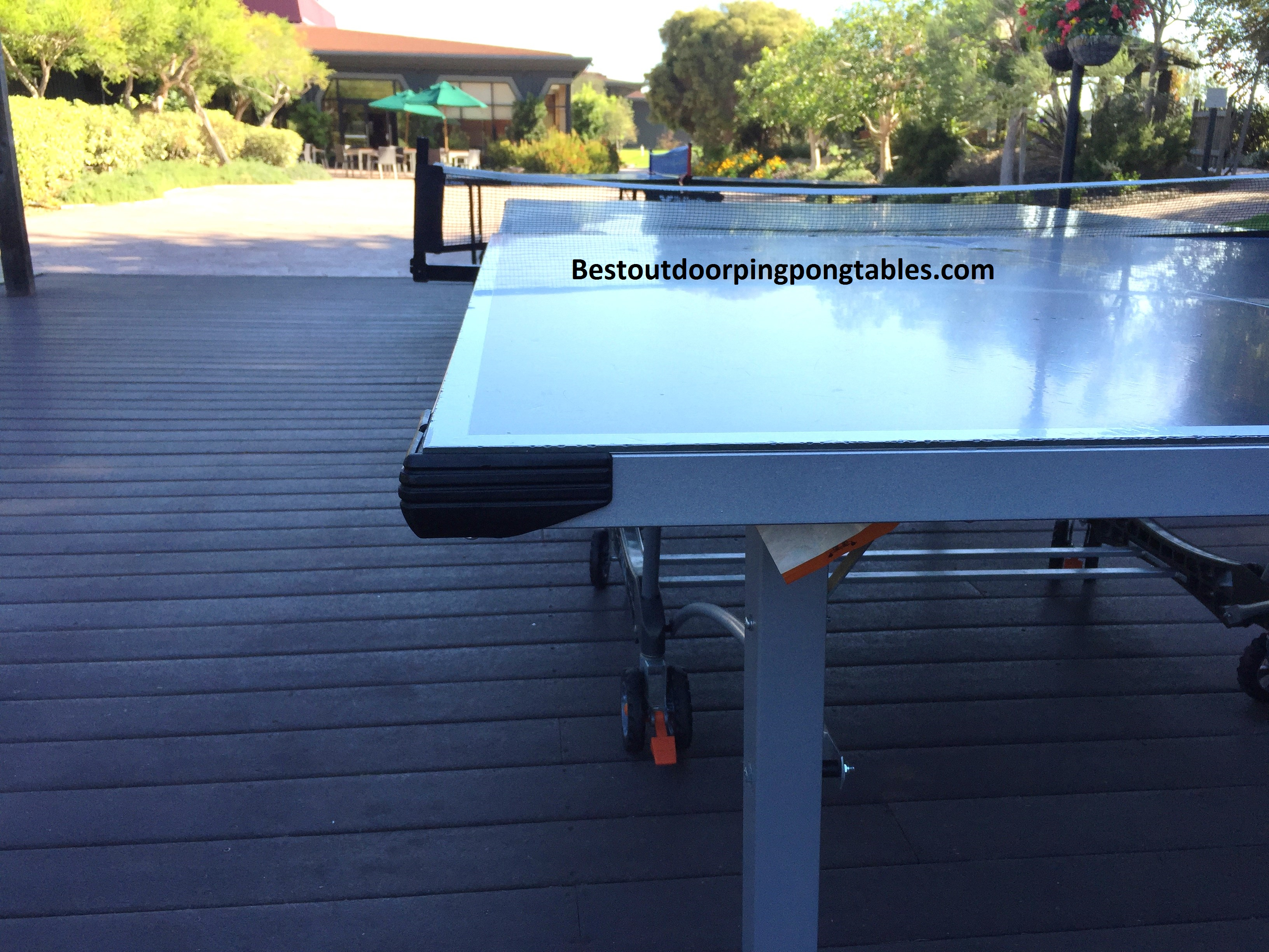Weatherproof Ping Pong Table ... these features if you have little kids running around the table