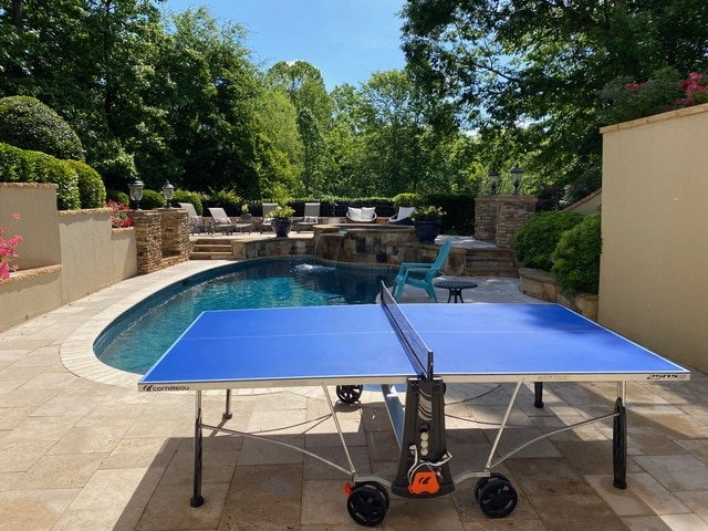 Cornilleau 250S ping pong table at pool